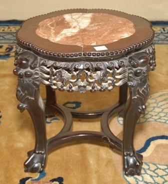 A CHINESE CARVED MAHOGANY STAND: