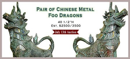 A PAIR OF CHINESE PATINATED METAL FOO DRAGONS:
