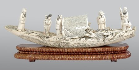 A CHINESE CARVED IVORY BOAT: