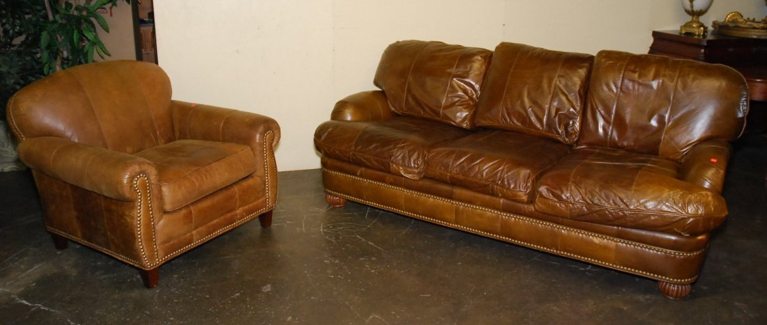 CONTEMPORARY LEATHER SOFA  AND OTTOMAN