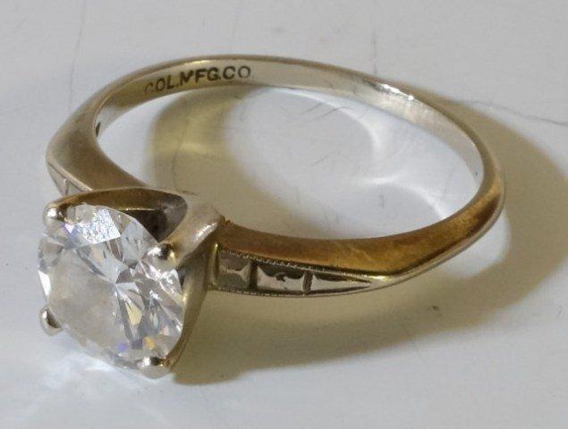 ROUND CUT DIAMOND SET IN 18K WHITE GOLD SETTING