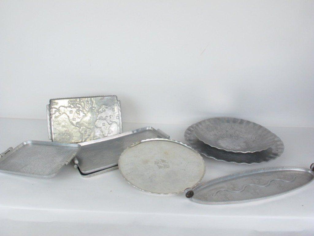 Eight Hammered & Embossed Aluminum Trays