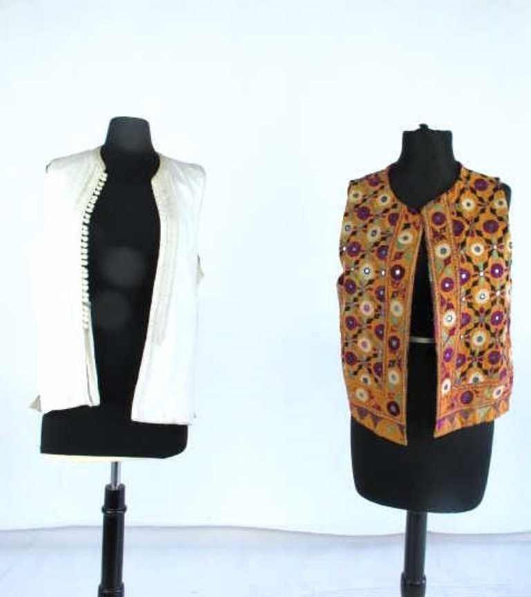 Two Embroidered Vests Two embroidered vests. One by