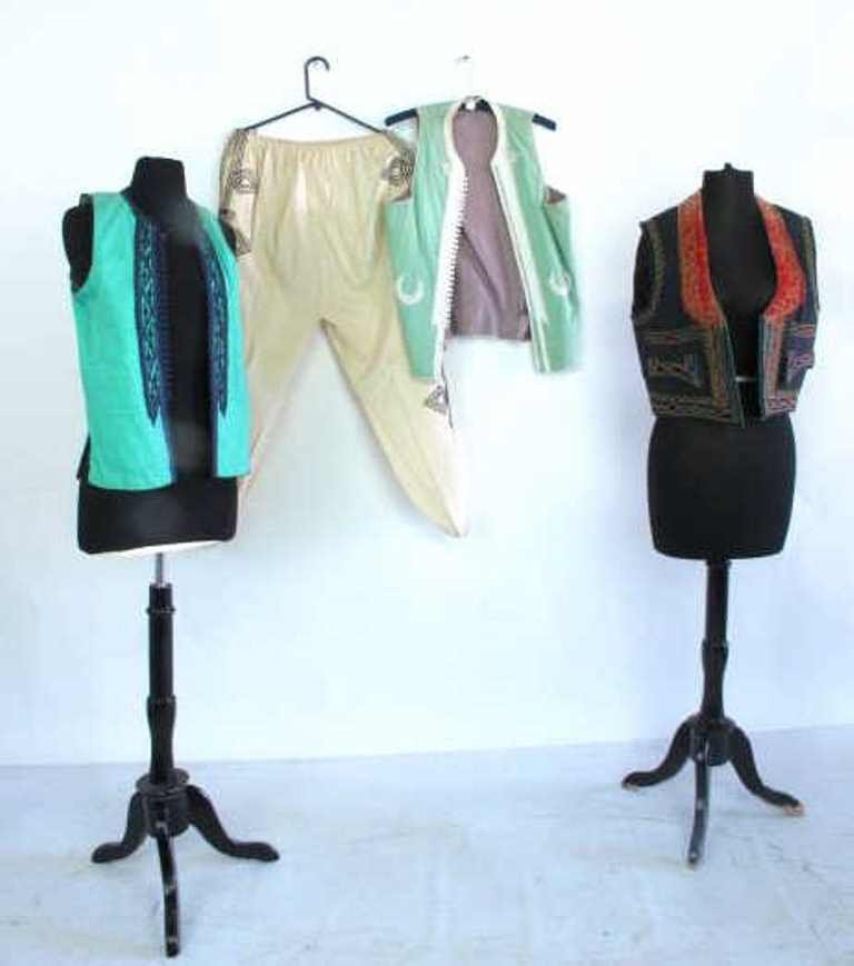 Group Lot of Three Vests and Pants Grouping of three