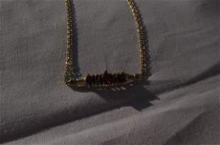 14kt gold garnet and diamond bracelet