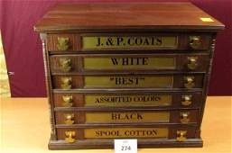 Antique wooden six-drawer spool cabinet with brass