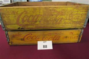 Two yellow Drink Coca-Cola crates