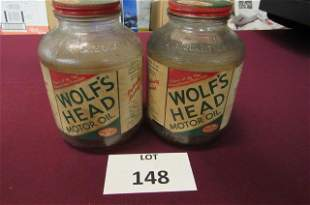 Lot of 2. Rare 1 quart Wolf's Head motor oil glass
