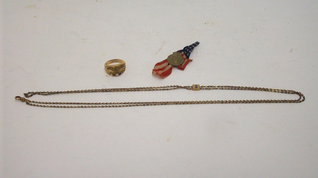 3: Lot of 3 pin, ring and chain.