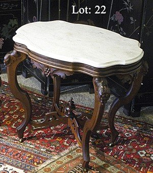 22: Victorian walnut and marble top console table.