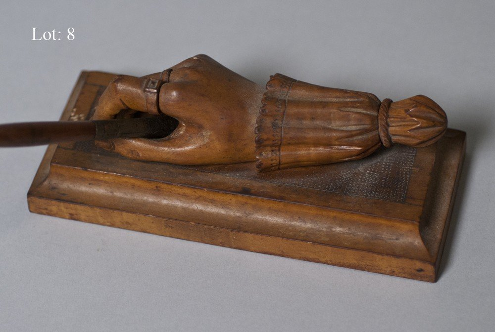 8: Carved hand desk accessory