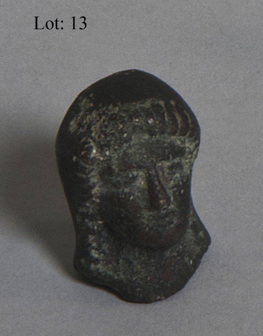 13: Miniature bronze head