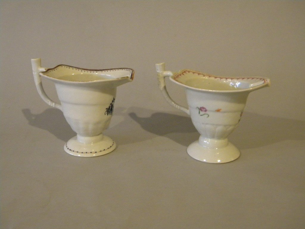 141: lot of 2 export pitchers, both floral decoration [