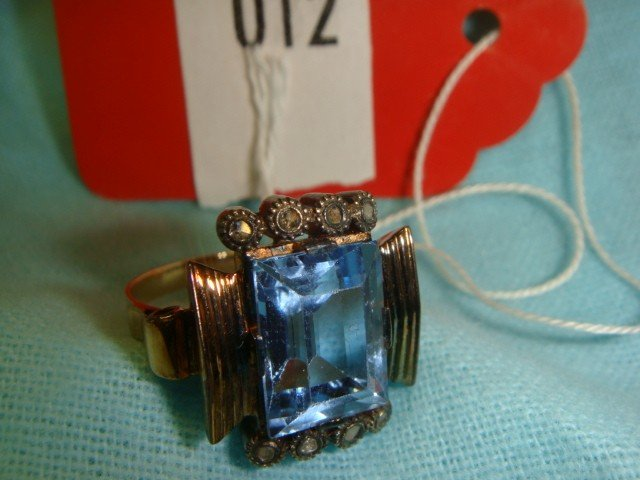 12: 14 K Gold Lady's Ring with Diamonds and Blue Stone