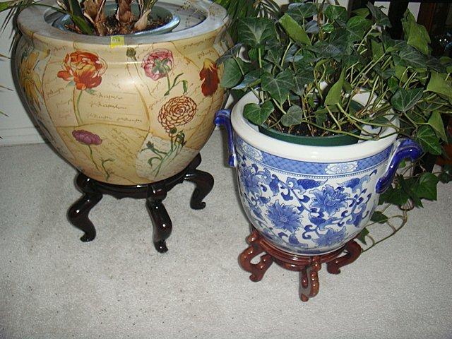 2 Oriental Design Porcelain Planters on Teakwood bases.