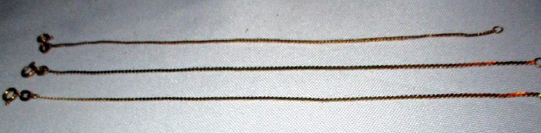 Three Gold Ankle Bracelets