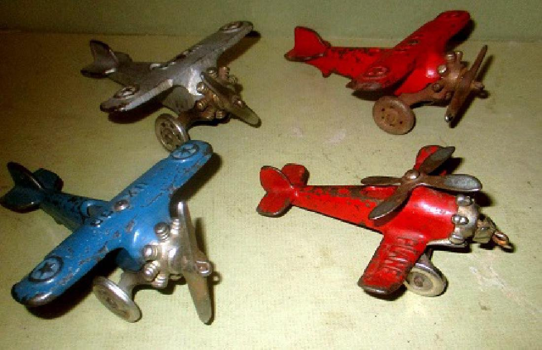 Four 1920/30s Cast Iron Toy Airplanes