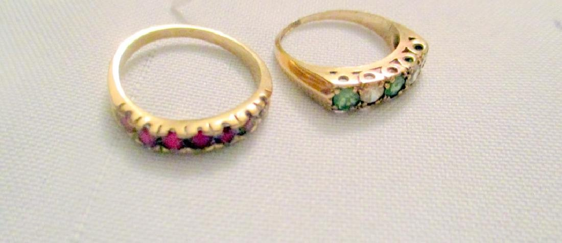 Two Gold Rings Set With Stones