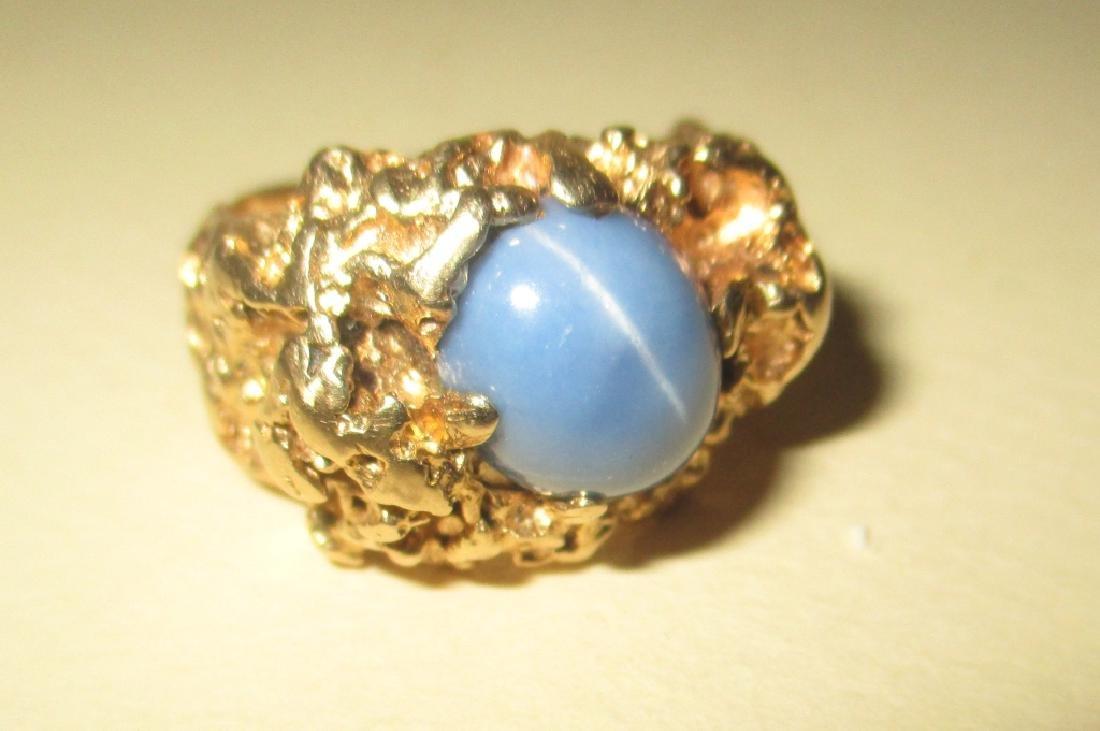 Man's 14k Gold Ring w/ Star Sapphire