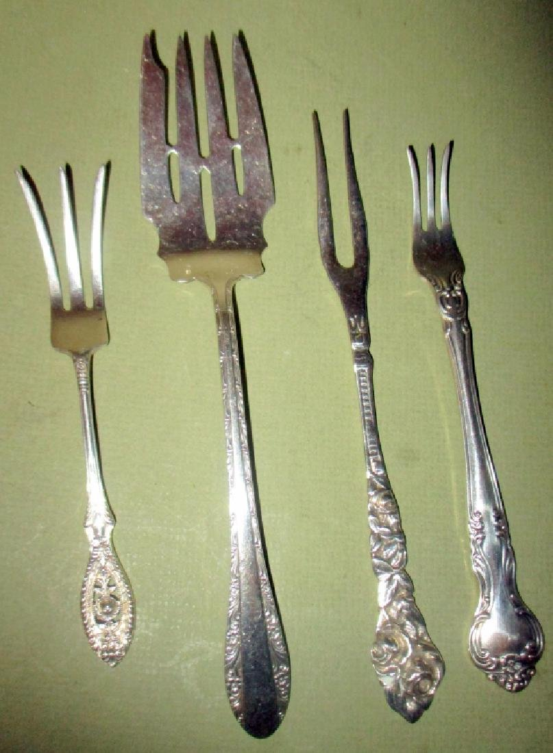 Four Sterling Serving Forks