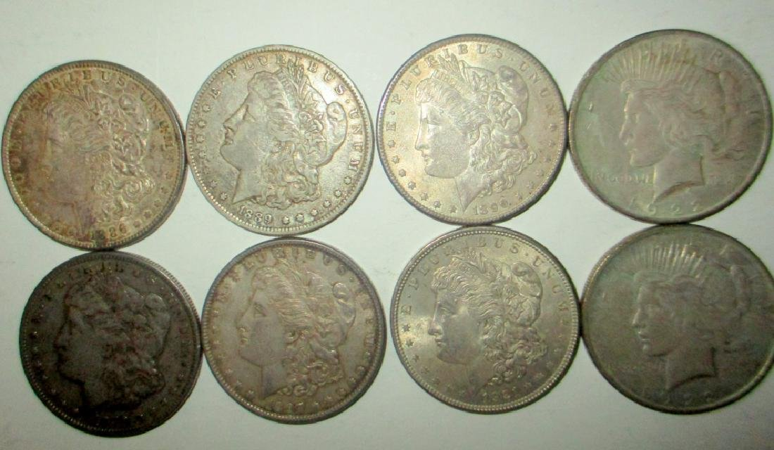 Lot of Eight American Silver Dollars