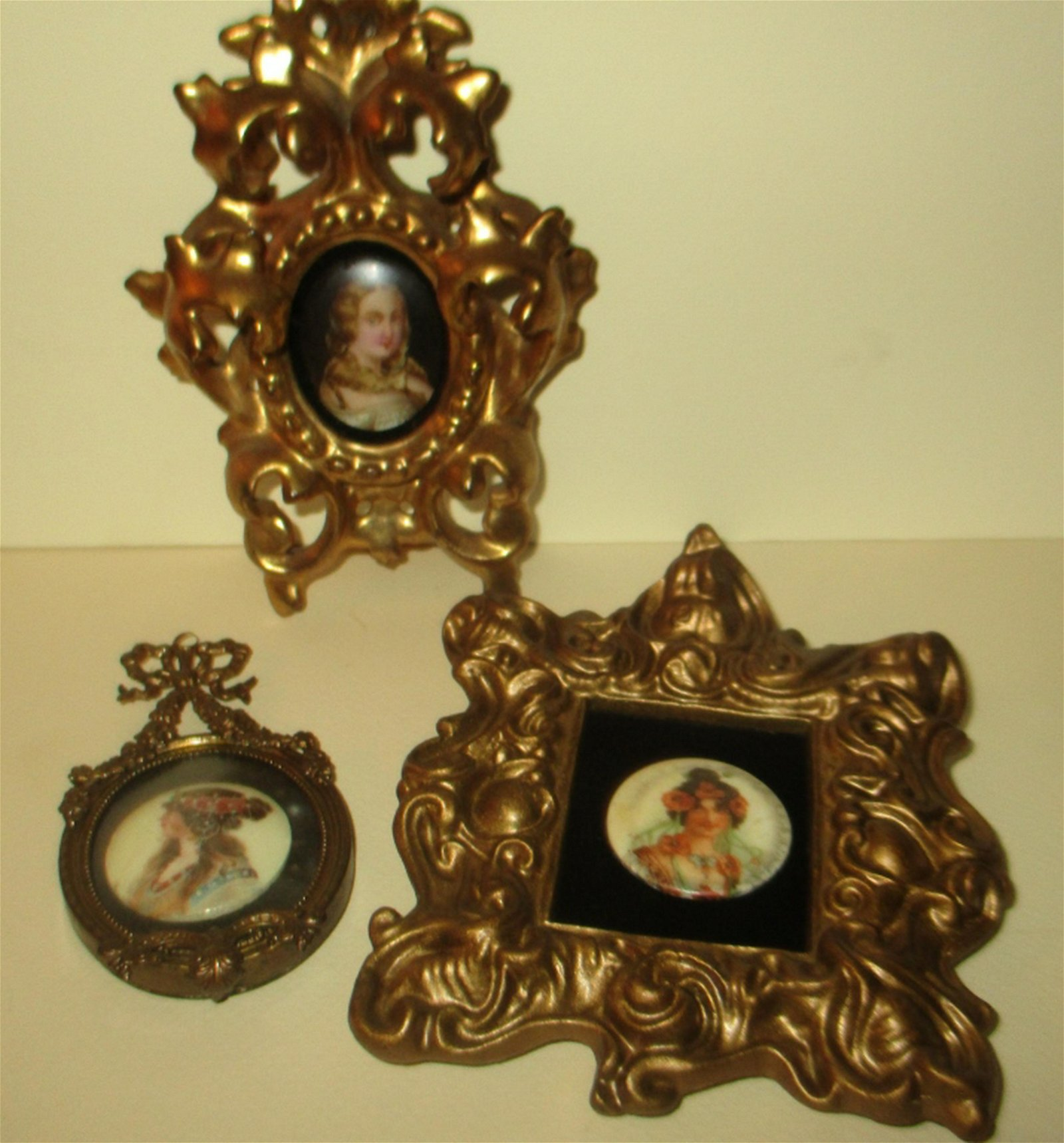 Three Framed Miniature Porcelain Plaques