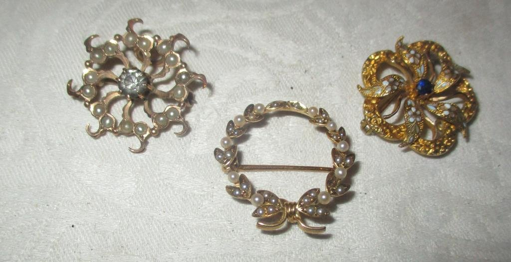 Three Small Lady's Pins Set with Stones
