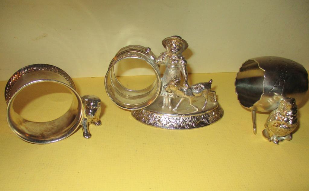 Three Victorian Figural Napkin Rings