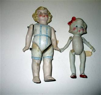 Two Vintage Bisque Porcelain Dolls