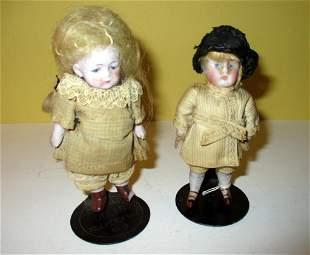 Two Miniature Bisque Porcelain Dolls