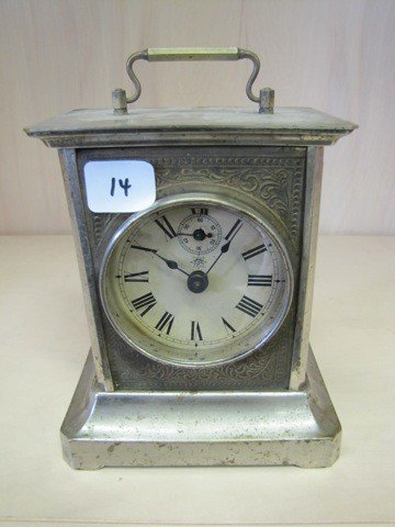 14: Carriage clock. Needs cleaned but looks really nie