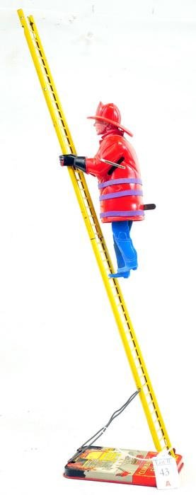 Marx Climbing Fireman Toy in Working Condition