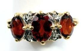 Ladies 10k Garnet & Diamond ring