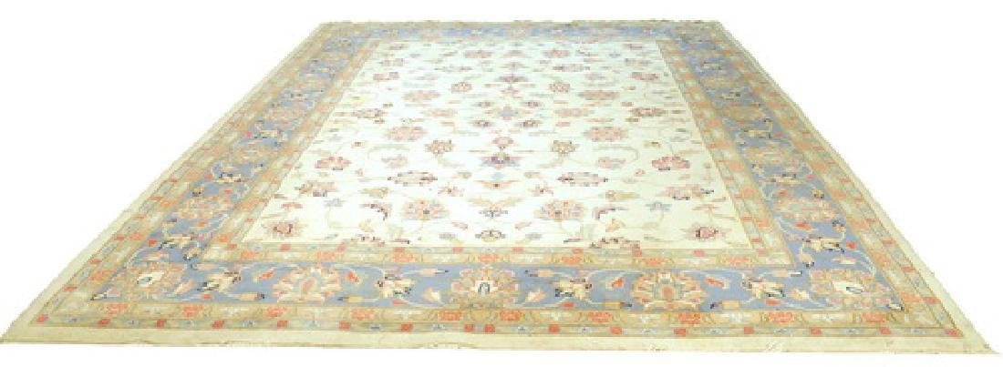 Wool rug with a light blue boarder
