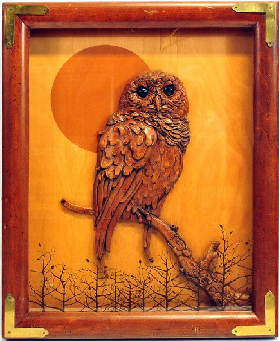 1 Shadow box of a carved wooden owl
