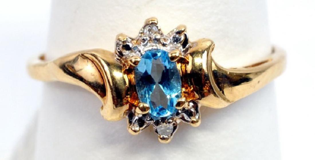 Ladies 10k Yellow Gold Blue Topaz & Diamond Ring