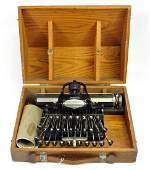 # 6 Buckensderfer Typewriter In Oak Case