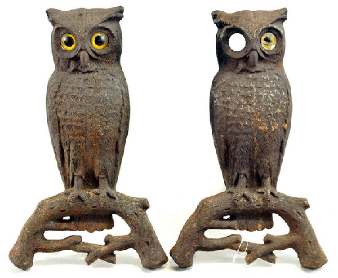 of antique cast iron owl andirons
