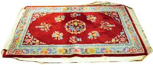 Two area floral rugs