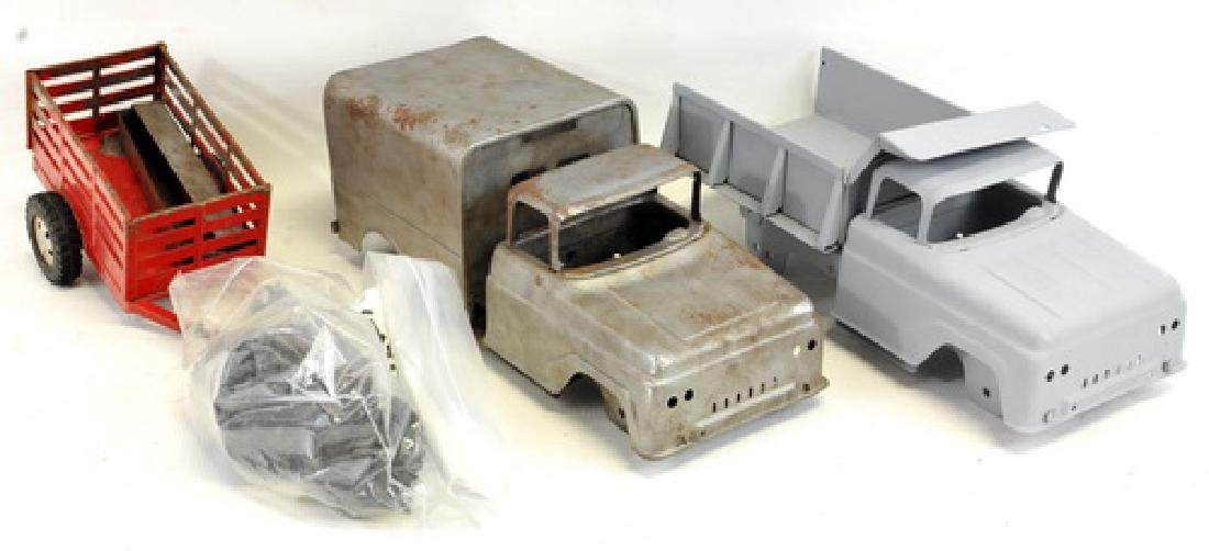 Three Boxes Of Pressed Steel Toy Truck Parts