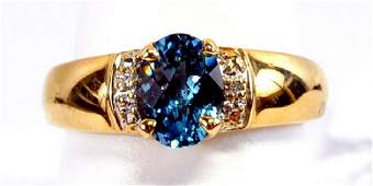 Ladies 10k Yellow Gold Blue Topaz  Diamond Ring
