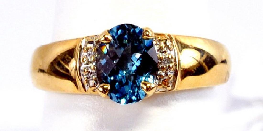 Ladies 10k Yellow Gold Blue Topaz & Diamond Ring