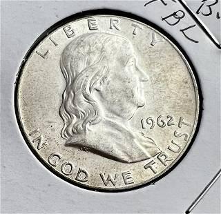 Three Uncirculated Franklin Half Dollars