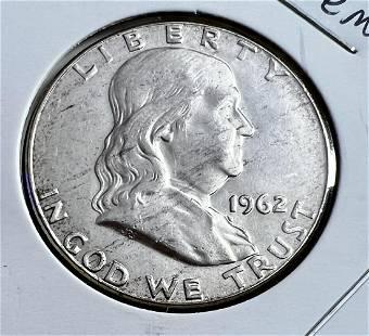Four Uncirculated Franklin Half Dollars