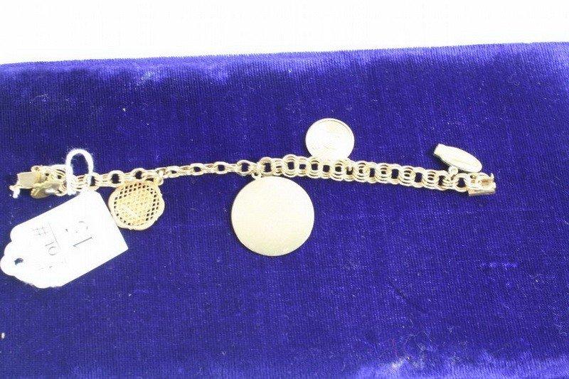 15: 14Kt. Charm Bracelet 20.57 DWT