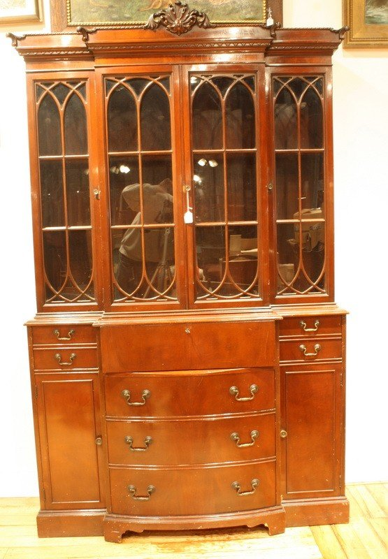 8: Two piece Mahogany Breakfront cabinet with drop fron