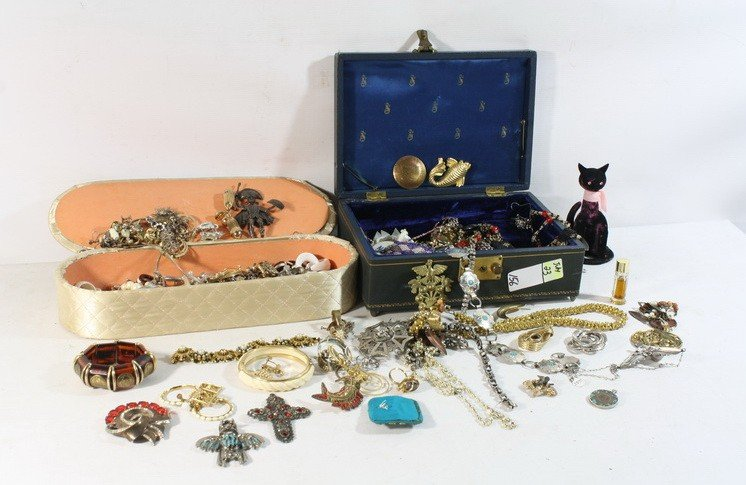 156: 2 cases of costume jewelry with sterling