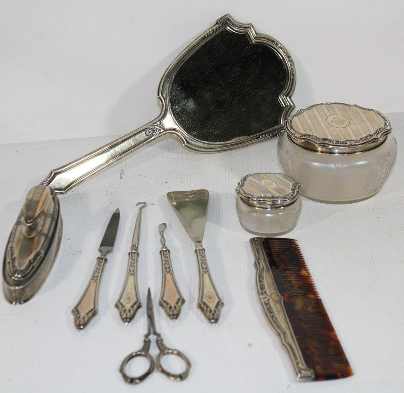 10: Sterling and gold dresser set