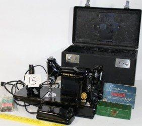 15: Singer model 221 Sewing machine