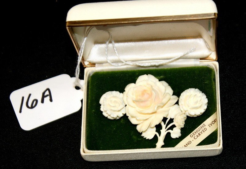 16A: Carved Ivory Earrings and brooch